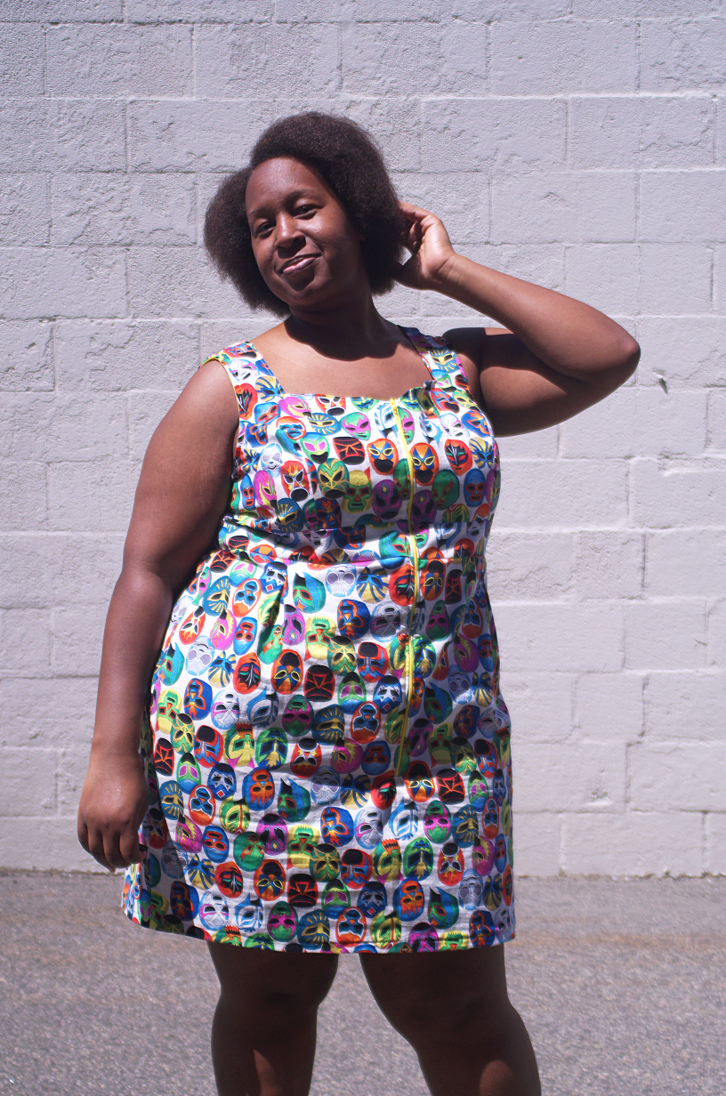 Wearing a dress of many colors with Making the Flame. Body positive sewing.